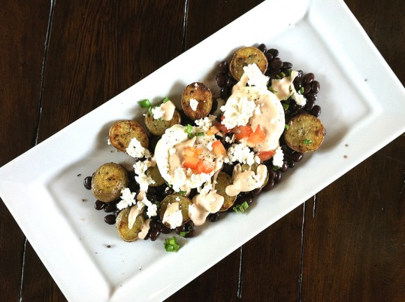 Poached Eggs with Crispy Potatoes, Black Beans, Goat Cheese & Chipotle Cream Sauce